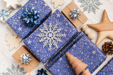 Presents in blue wrapping paper with silver sparkles and wooden decorations