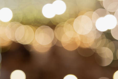 Abstract composition. Beautiful blurred Christmas interior , warm yellow lights, candles, toned