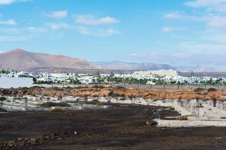 View of the unfinished houses in Costa Teguise, Lanzarote, Canary islands, selective focus