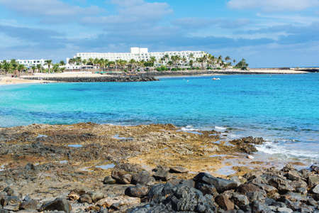 View of Playa de las Cucharas beach in Costa Teguise, Lanzarote, Spain, turquoise waters, selective focus