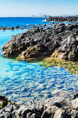 Lagoon with turquoise clear water in Playa Jablillo beach, in Costa Teguise, Lanzarote, Canary islands, selective focus Stockfoto - 116121400