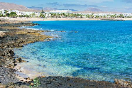 View of Playa de las Cucharas beach in Costa Teguise, Lanzarote, Spain, turquoise waters, selective focus
