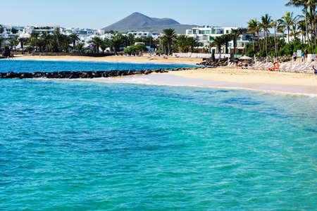 COSTA TEGUISE, LANZAROTE - 22 December 2018. Las Cucharas beach, Lanzarote, Canary islands. VIew of the sea, sandy beach and mountains, selective focus Editorial