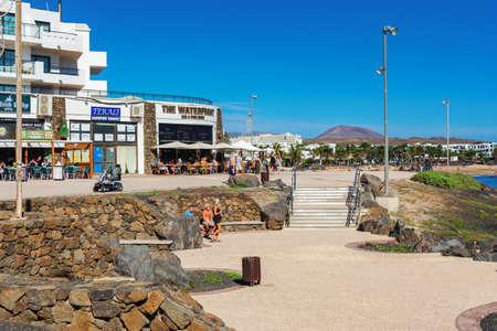 COSTA TEGUISE, LANZAROTE - 26 December 2018. Cafes and shops in Las Cucharas beach, Lanzarote, Canary islands, selective focus