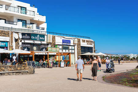 COSTA TEGUISE, LANZAROTE - 26 December 2018. Cafes and shops in Las Cucharas beach, Canary islands, selective focus