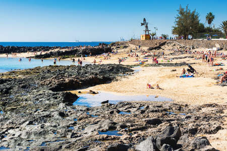 COSTA TEGUISE, LANZAROTE - 26 December 2018. People in Playa Jablillo beach, Canary islands, selective focus Editorial