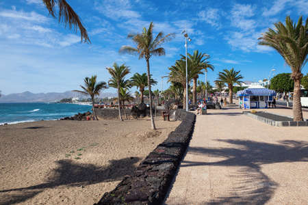 PUERTO DEL CARMEN, LANZAROTE - 23 December 2018. Beach, blue sea, palm trees, selective focus