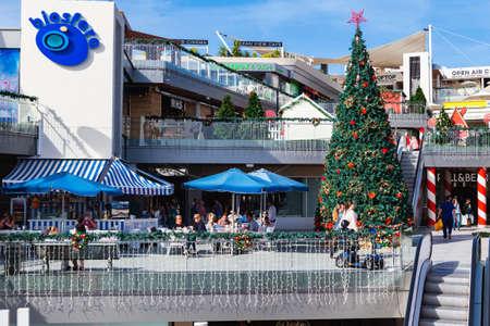 PUERTO DEL CARMEN, LANZAROTE - 23 December 2018. Shops and people in Biosfera shopping centre in Puerto del Carmen in Lanzarote, Canary islands, Spain, selective focus