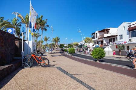 PUERTO DEL CARMEN, LANZAROTE - 23 December 2018. Shops and people in Puerto del Carmen in Lanzarote, Canary islands, Spain, selective focus Editorial