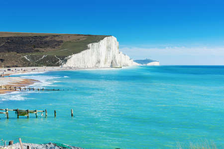 Beautiful Cuckmere Haven near Seaford, East Sussex, England. South Downs National park. View of blue sea, white cliffs, beach, selective focus