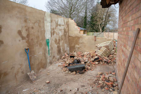 Demolition works in the residential property, destroyed garage, rubble and blocks