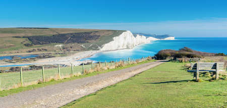 Walk in Cuckmere Haven near Seaford, East Sussex, England. South Downs National park. View of blue sea, cliffs, beach, green fields, long photo banner, selective focus 写真素材