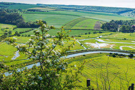 High and over side road view point near Seaford, East Sussex, England. View of Cuckmere river from above, selective focus
