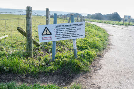 Seaford Head coastal path. Walk to Hope Gap and Cuckmere Haven beaches with further access to Beachy Head near Seaford and Eastbourne, East Sussex, UK, selective focus. Seaford England - 26 March 2020