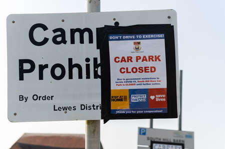 Sign in South Hill barn saying car park closed due to Covid-19. Access to to Hope Gap and Cuckmere Haven beaches, East Sussex, UK, selective focus. Seaford, England - 10 April 2020 Editorial