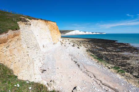 Hope Gap beach near Seaford and Eastbourne, East Sussex, England. South Downs National park. View of blue sea, cliffs, selective focus
