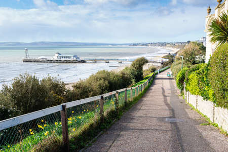 Bournemouth pier, Dorset, England, view of the blue sea and the road to the beach, selective focus Stock Photo