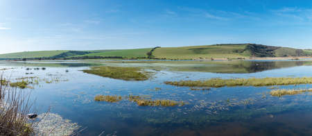 Views of Cucmere river near Seaford and Eastbourne, East Sussex, from Friston forest, beautiful reflections, panoramic photo, long banner, selective focus