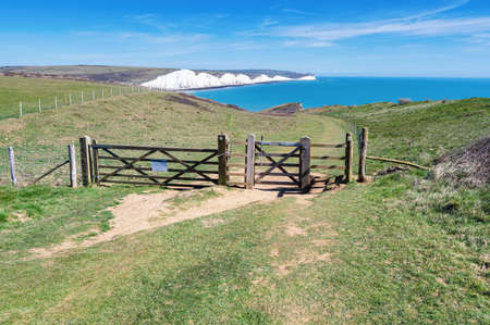Walk to Cuckmere Haven beach near Seaford and Eastbourne, East Sussex, England. South Downs National park. View of blue sea, cliffs, selective focus Stock Photo