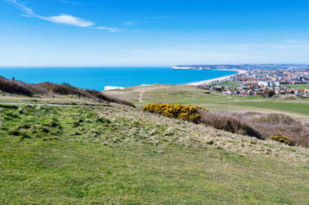 View of Seaford town in East Sussex, England from the golf course, beach and blue sea, selective focus