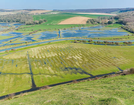 Views of Cucmere river near Seaford and Eastbourne, East Sussex from High and Over, footpath leading to Cuckmere Haven and Hope Gap beaches, country walks, selective focus 스톡 콘텐츠