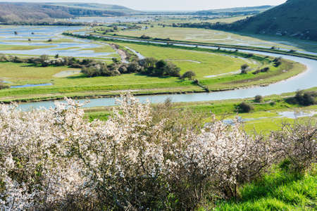 Views of Cucmere river near Seaford and Eastbourne, East Sussex near High and Over viewing point, fCuckmere Haven beach in a distance, country walks, selective focus