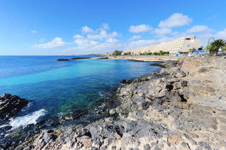 Lagoon with turquoise clear water in Playa Jablillo beach, in Costa Teguise, Lanzarote, Canary islands. Sandy beach with blue sea, volcanic rocks