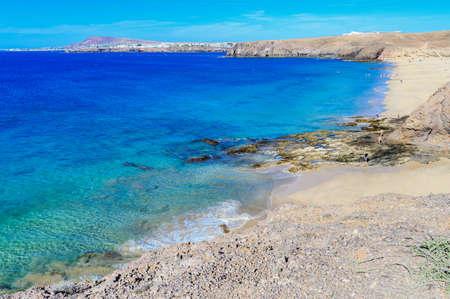 View of beautiful Playa de la Cera beach, from above, blue sea, yellow sand, cliffs. Papagayo, Playa Blanca, Lanzarote, Canary Islands, selective focus Stock Photo