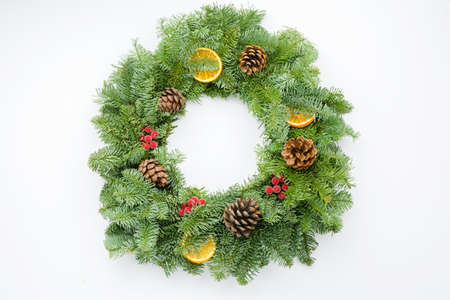 Top view of handmade Christmas wreath on white table, selective focus