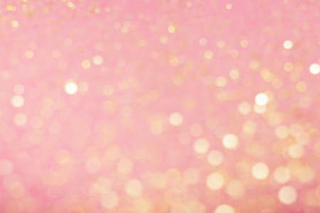Abstract composition. Blurred photo of glitter with beautiful bokeh in pink. Defocused light. Stock Photo