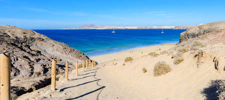 View of beautiful Playa de la Cera beach, from above, blue sea, yellow sand, cliffs. Papagayo, Playa Blanca, Lanzarote, Canary Islands, selective focus 版權商用圖片
