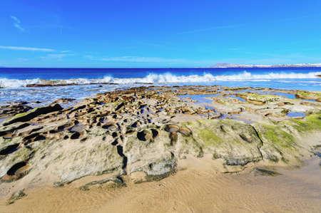 View of beautiful Papagayo beach, blue sea, yellow sand, cliffs. Playa Blanca town, Lanzarote, Canary Islands, selective focus 版權商用圖片