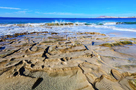 View from beautiful Playa de la Cera beach, blue sea, yellow sand, rock pools, Papagayo, Playa Blanca, Lanzarote, Canary Islands, selective focus