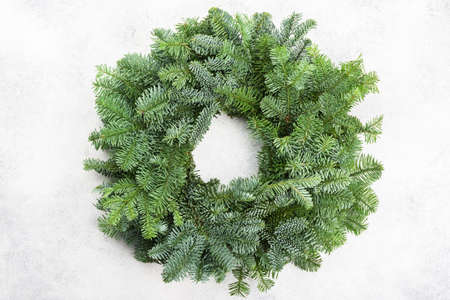 Handmade Christmas wreath on the white table, top view, selective focus