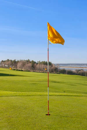 golf flag in the 18th hole photo