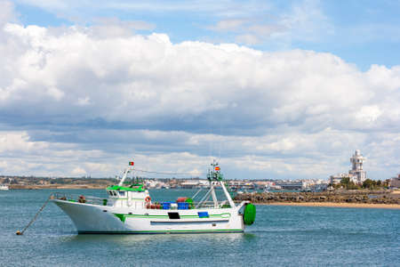 fishingboat: Fishing-boat in the Guadiana River between spain and portugal Stock Photo