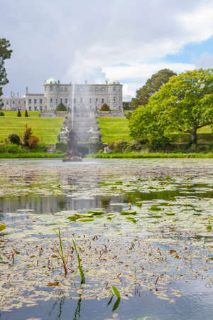 italian fountain: Enniskerry, Ireland - May 11, 2014: Fountain of the Triton Lake in the Italian Garden at Powerscourt State. Powerscourt State was voted the third garden in the World by National Geographic in Sniskerry, Ireland on May 11, 2014 Editorial