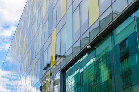 Wall of Glass building with surfeillance camera system