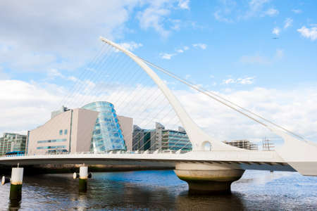 samuel: Dublin, Ireland - June 01, 2014: Samuel Beckett Bridge in Dublin, Ireland on June 01, 2014. Beautiful Bridge looks like an harp over Liffey River Editorial