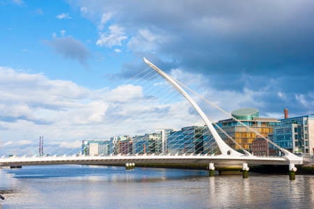 Dublin, Ireland - June 01, 2014: Samuel Beckett Bridge in Dublin, Ireland on June 01, 2014. Beautiful Bridge looks like an harp over Liffey River
