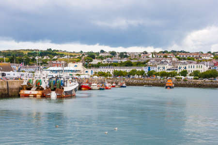 Fishing boat docked in the harbor at Howth