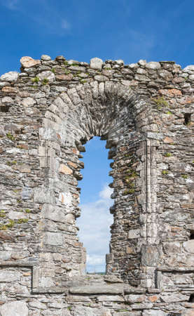 monastic site: The Old Window in The Cathedral in Glendalough, wicklow mountains, Ireland Stock Photo
