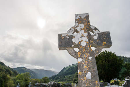 Old Celtic Cross in The Glendalough s Cemetery. Wicklow mountain, Ireland