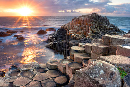 Sunset at Giant s Causeway in North Antrim, Northern Ireland Фото со стока