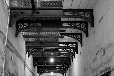 gaol: Black and white corridor in kilmainham Gaol in Dublin, Ireland