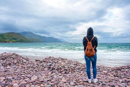 co kerry: Casual woman in front of the sea in Rossbehy, Ring of Kerry, Ireland