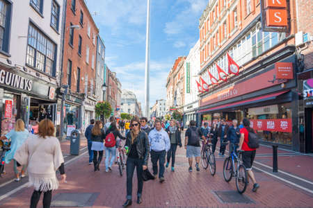 Dublin, Ireland - Sep 27, 2014: People at Talbot Street with Spire at background in Dublin, Ireland on September 27, 2014