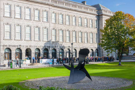 Dublin, Ireland - Oct 25, 2014: View of the people queue at the front of the Book of Kells at Trinity College in Dublin, Ireland on October 25, 2014