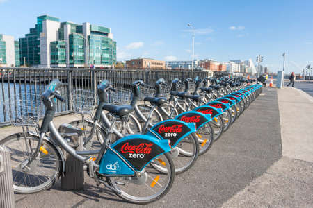 liffey: Dublin, Ireland - Oct 25, 2014: Dublin bikes with the Cocacola zero sponsor at the Liffey river in Dublin, Ireland on October 25, 2014 Editorial