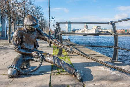 linesman: Dublin, Ireland - Oct 25, 2014: The Linesman statue at Liffey river in Dublin, Ireland on October 25, 2014